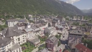 Aerial-Stock-Footage-Fast-Flying-Backwards-Over-Chamonix-in-Summer