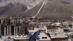 Aerial-Stock-Footage-of-Chamonix-Rising-up-Rotate-and-Reveal-Winter-Snow